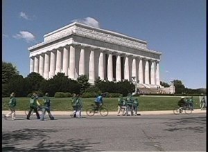 stock-footage-people-walk-and-bicycle-near-the-lincoln-memorial-in-washington-dc